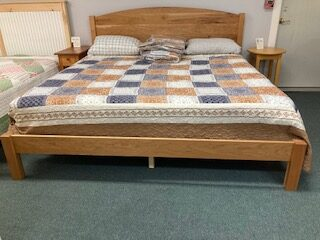 Arched panel bed